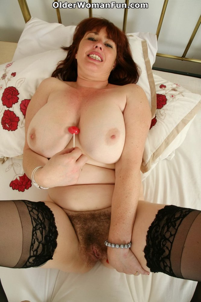 year old uk milf janey strips off her clothes photo