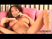 Curly latina takes a big dildo in her pussy