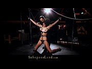 Tall slave girl hooked in suspension for bdsm pain