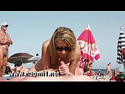 Picture Naomi1 handjob a young guy on a public beach