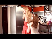 lesbian sexy duo stripping and kissing passionately
