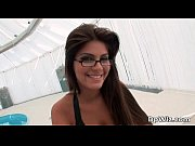 Attractive and hot brunette blowing tube
