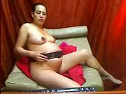 pregnant beauty shows her belly - PregnantHorny.com