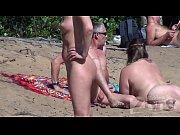 Picture Voyeur blowjob on a nudist beach