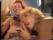 Picture Jeanna Fine and Nina Hartley both sucking a guys...