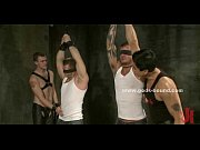 Men use whips to play with gay slaves