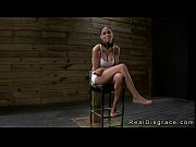 Busty brunette Jasmine Caro chained to a post a...