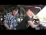 gay hunks gathered in public bar