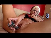 Blonde beauty plays with dildo