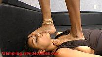 Brunette Girl Trampling Hard Slave Girl Face an... thumb