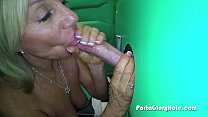 Porta Gloryhole Mature lady sucks cock in porta...