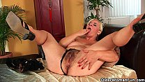 Busty soccer mom probes her hairy pussy with ha...