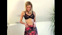 Beautiful blonde stripping out of her lingerie thumbnail