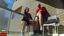 She swallows her milk on the balcony in front o...