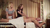 Old man gets oil massage from two beautiful tee...