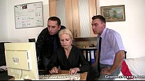 Two dudes share old blonde in the office