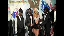 Blonde Entertains a Group of Blacks