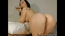 Tattooed babe toys her pussy and ass on cam