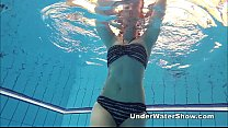Redheaded cutie swimming nude in the pool porn videos