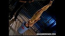 Skinny Japanese chick tied up and drenched in hot wax