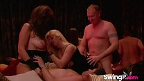 Horny mature couple having fun at a swinger orgy