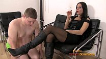 female dominatrix using a slave like an ashtray