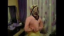 Arab Turkish girl with hijab turban being mastu...