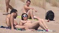 She fucks a guy in a beach full of voyeurs