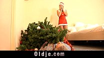 Silly girl and old man gets down near the Christmas tree porn videos