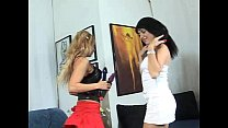Two hot italian lesbians are playing with a rubber cock thumbnail