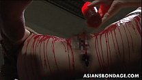 Asian babe get her privates covered in wax. porn videos