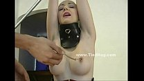 Brunette with black gloves is tied up
