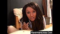 Brunette Amy Anderson gives a harsh handjob