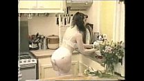Housewife playing in kitchen