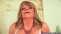 grandmother with large breasts pushes huge dild…