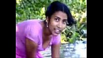 village girl bathing in river showing assets ww...