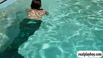 Girl in monofins swimming while topless for som...
