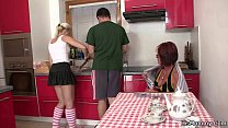 future mother and woman toying at the kitchen