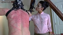 Hooded femdom slave is whipped and stomped by T...