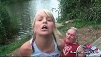 Gorgeous blonde rides dick on the river shore