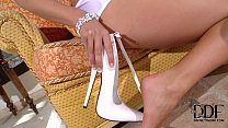 eva parcker tempts in a skimpy white teddy and 7 inch pumps