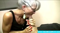 Mature mother with spex sucking cock