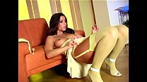 long haired babe stripping out of her sexy nylons