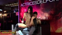 brunette babe and guy from public on stage