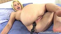 Delphine sticks a long tube up her ass