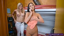 Lesbian reaches orgasm in a solarium with a little help