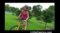 Little Caprice riding bicycle naked outdoors