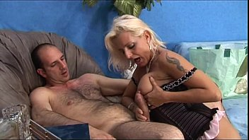 Sexy MILF is naked in bed