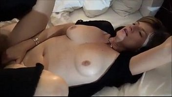 Classy brunette uses her amazingly big tits on a dildo
