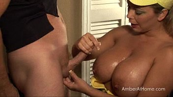 Big boob amber jacks a guy off at home.